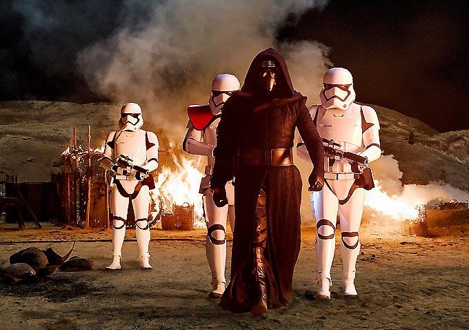 Kylo Ren (Adam Driver) with Stormtroopers..Ph: David James..©Lucasfilm 2015