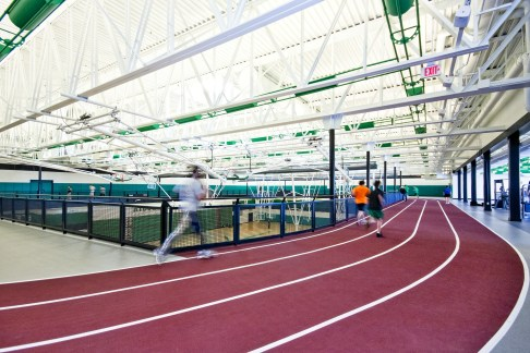 Adding to the rhythm of visual activity is a running track suspended from the joist structure above