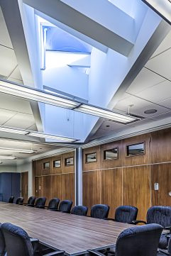 To enhance flexibility and encourage small breakout meetings movable partitions where installed in the main conference room allowing it to open to a lounge-style seating arrangement.