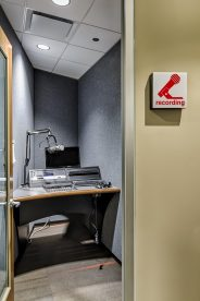 The acoustically isolated Audio Recording Studio allows staff to create crisp recordings with their existing equipment.