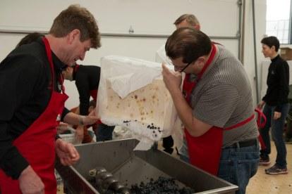 Greg & Brian Pencak destemming and crushing grapes