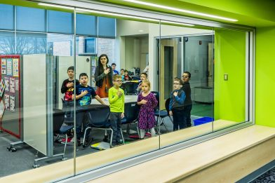 By maximizing transparency into the corridor, natural light filters into interior spaces in addition to putting learning on display. The reading rooms support small group engagement and have built-in bench seating that provide alternative areas for learning inside and directly outside of the space.