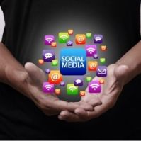 Hand holding social media tabs with the word social media in the middle.