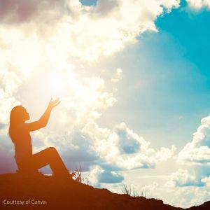 woman raising arms to the sun
