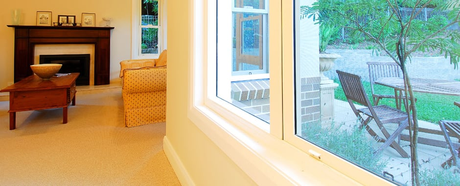 A pair of Double Hung Windows in a living room