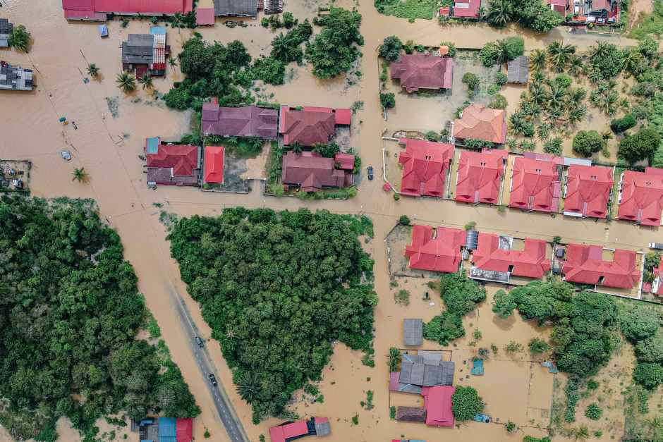 roofs of residential houses in flooded town