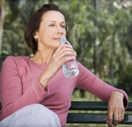 Over 50 woman drinking water