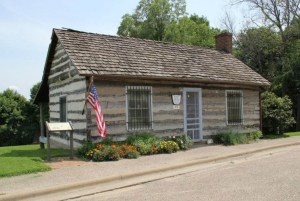 The Hawkeye Log Cabin Museum local high on the bluff overlooking the Mississippi River.