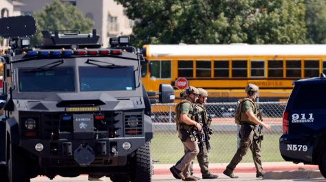 Tactical officers clear the scene following a shooting inside Mansfield Timberview High School in Arlington, Texas, Wednesday, October 6, 2021. Four people were injured in the shooting and the suspect turned himself into the Arlington police. (Tom Fox/The Dallas Morning News)