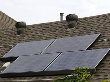 This 2019 file photo shows solar panels on a roof in Allen.