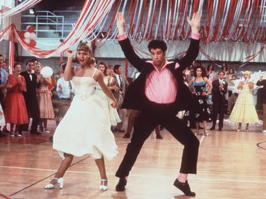 """Olivia Newton-John and John Travolta do their thing in """"Grease,"""" one of the movies showing at the new drive-in."""