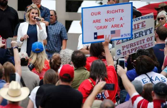Shelley Luther, owner of Salon a la Mode in Dallas, speaks to the crowd during the Set Texas Free Rally at Dealey Plaza in Dallas on Saturday, May 9, 2020. (Vernon Bryant/Dallas Morning News/TNS)
