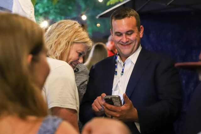 Adam Bazaldua, Dallas City Council District 7 candidate, smiles with his mother Pam Bradford (left) as they looks at results during an election night watch party at Eight Bells Alehouse Dallas, Saturday, May 1, 2021. (Elias Valverde II / Special Contributor)