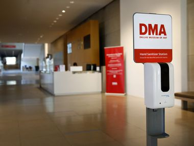A hand sanitizer station appears at the entrance of The Dallas Museum of Art on Friday, Aug. 7, 2020. The museum is in the process of installing safety features in preparation for its planned reopening on Aug. 14.