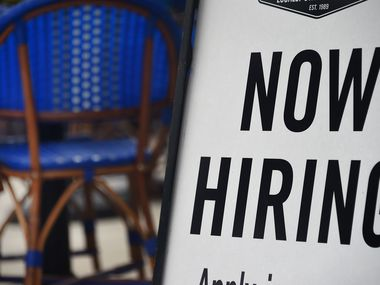 """A Virginia restaurant displays a """"Now Hiring"""" sign, a reflection of growing demand for food service workers. In June, the food and lodging industry had 719,000 job openings, according to federal data."""