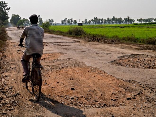pot-holed road, west bengal