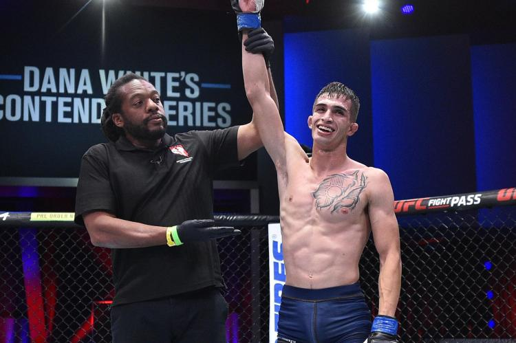 There aren't many positive photos of Jerome Rivera to chose from, so have his hand being raised after his DWCS success | Zhumagulov vs Rivera