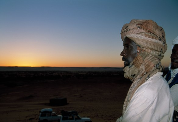 geno_2_A man looks into the sunset in the Sahara Desert_Photo by David Evans