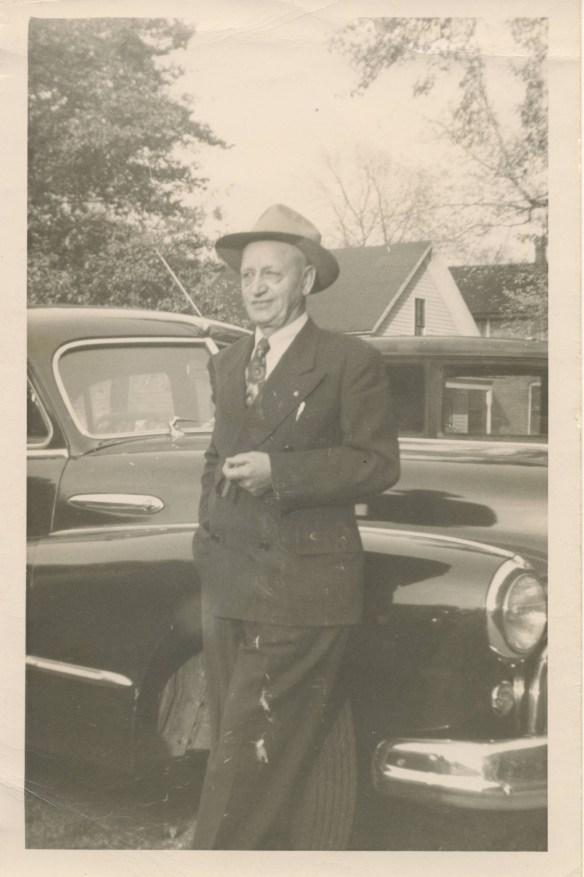John Ferverda against car
