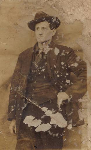 William George Estes in tie