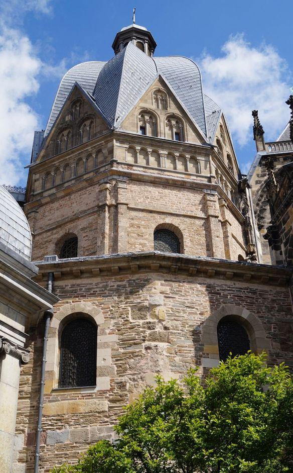"""Aachener Dom Pfalzkapelle vom Münsterplatz 2014"" by CaS2000 - Own work. Licensed under CC BY-SA 3.0 via Commons"