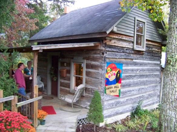 Nicholas Speaks cabin Dolores on porch.jpg