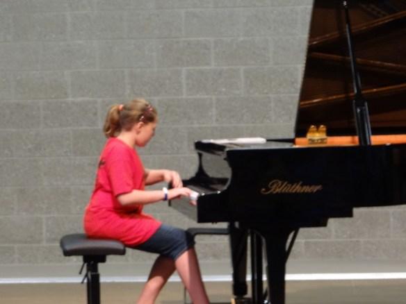 Phoebe and piano.jpg