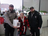 Wardens Joe Paul and Nic Hefter with Florence Teeters.'