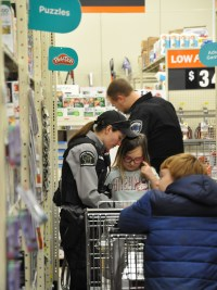 Warden Kaitlin Kernosky at Shop with a Cop at Waupaca County.