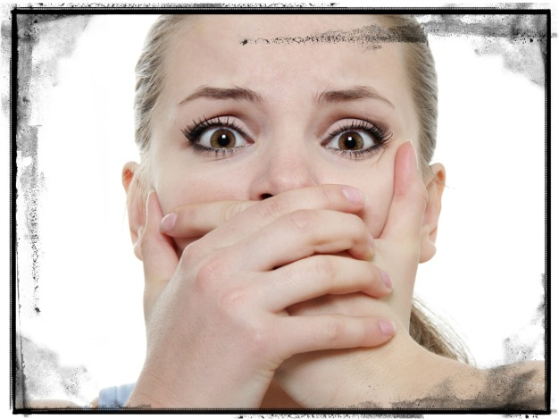 Woman Hands Over Mouth