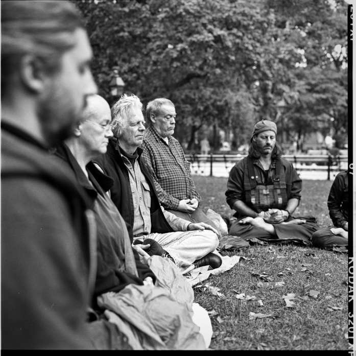 October 6, 2009. A street retreat led by Genro Sensei and Enkyo Roshi, attended by members of the Village Zendo and other sanghas. A dozen Zen students spent 4 days on the streets of lower Manhattan. The group meditates in Washington Square Park.