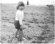 Elizabeth at the beach as a child.