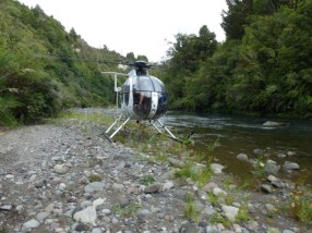 Helicopter beside a river. Photo: Sarah Ridsdale.