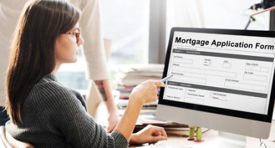 woman filling financial information form online