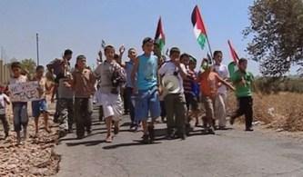 5-broken-cameras-children-marching