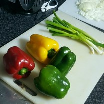 Yummy mixed peppers. Cut 'em open, scoop out the seeds and the white bits, and dice them into small chunks