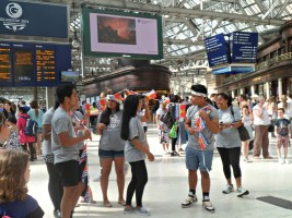 Athletes from Kiribati arrive at Central Station in Glasgow