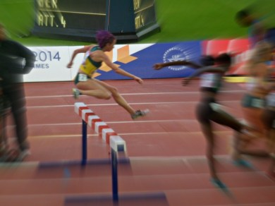 Jump during the women's steeple chase at Glasgow 2014