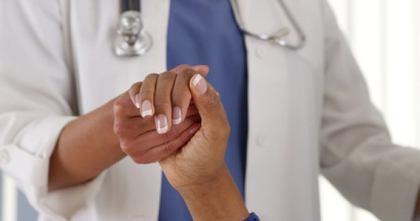 Doctor holding hands