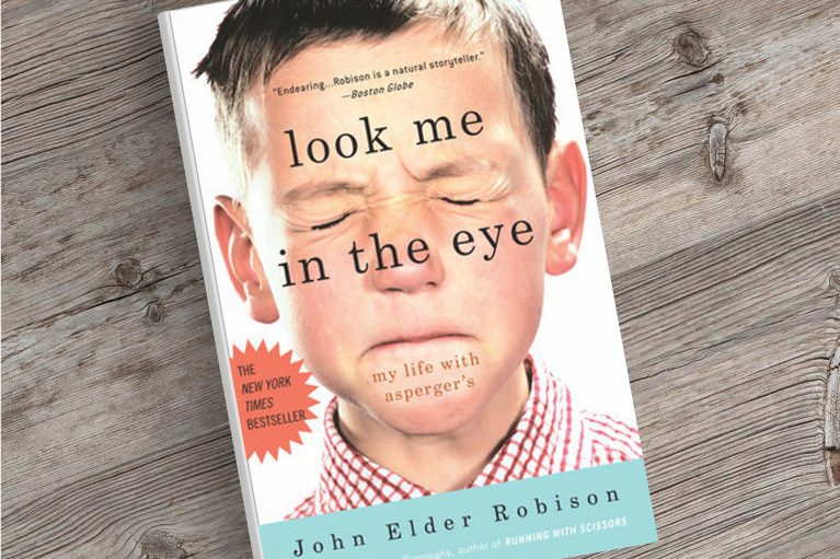 An image of the novel Look Me In The Eye on a desk.