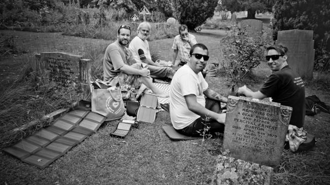 People sat round Orwell's grave on his birthday.