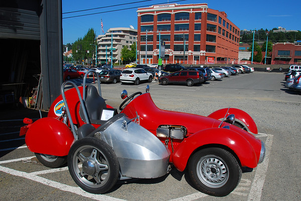 A red car with a side car