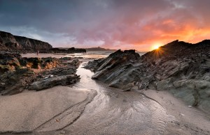 Sunset at dog friendly Lusty Glaze beach at Newquay in Cornwall