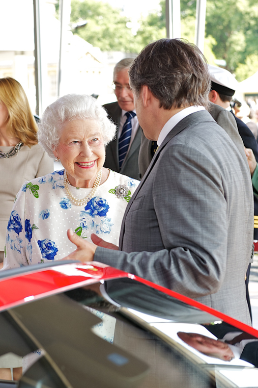 Her Majesty Queen Elizabeth II and Ralf Speth attend the Jaguar Land Rover Pavillion at The Coronation Festival at Buckingham Palace, London, 11th July 2013.