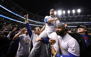CLEVELAND, OH - NOVEMBER 02: Anthony Rizzo #44, David Ross #3 and Jason Heyward #22 of the Chicago Cubs celebrate with actor John Cusack (R) after defeating the Cleveland Indians 8-7 in Game Seven of the 2016 World Series at Progressive Field on November 2, 2016 in Cleveland, Ohio. The Cubs win their first World Series in 108 years. (Photo by Ezra Shaw/Getty Images)
