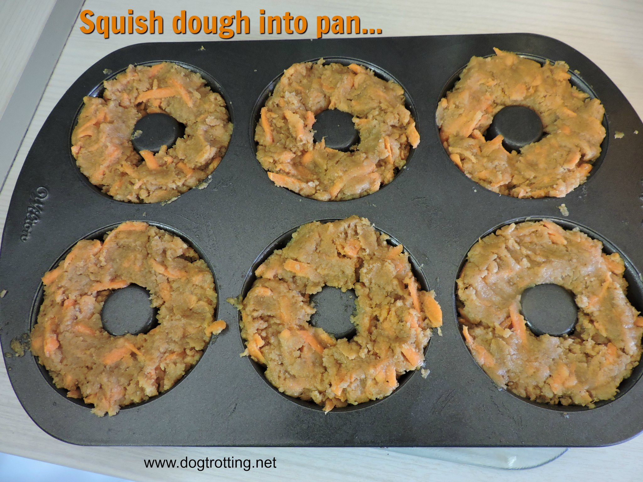 unbaked dog donut treats in a pan