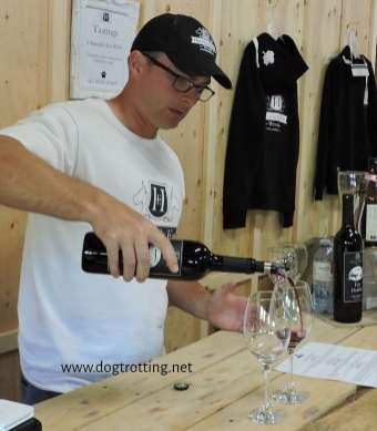 pouring wine at Hounds of Erie Winery