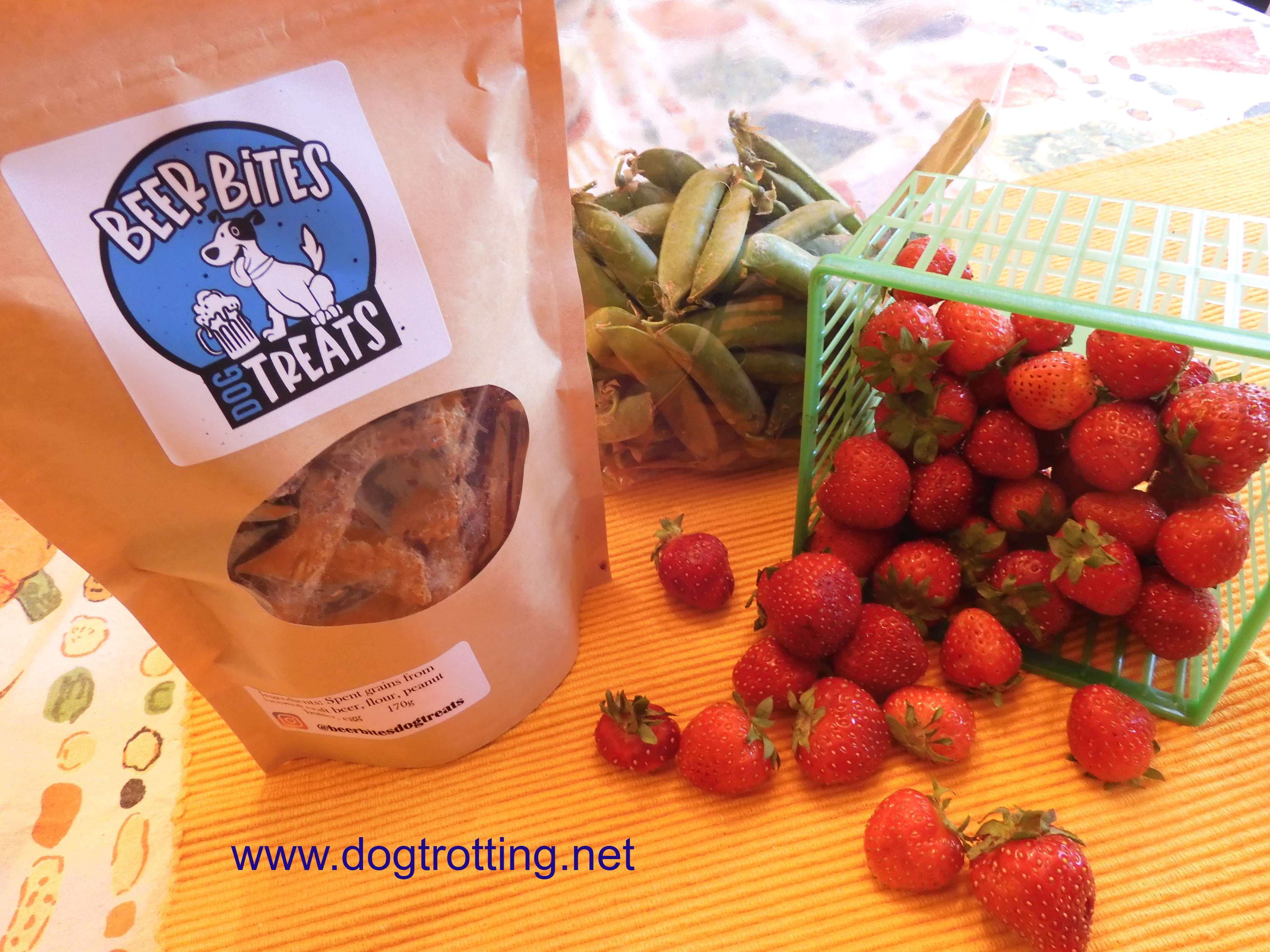 bag of Beer Bites dog treats, green peas and strawberries from farm stand in Selkirk, Ontario, Canada
