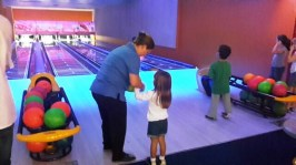 Mom teaches one of our younger bowlers