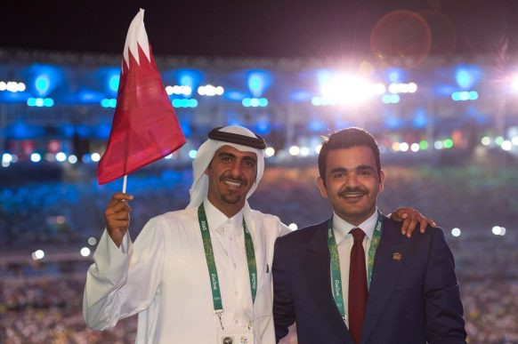 Sheikh Joaan with flag bearer Sheikh Ali during the Opening Ceremony